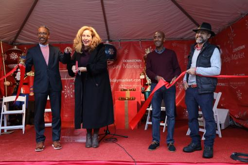 Director Whitfield cuts ribbon at DowntownDC BID holiday market