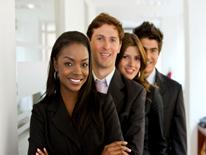 Group of business people standing and smiling while looking at the camera